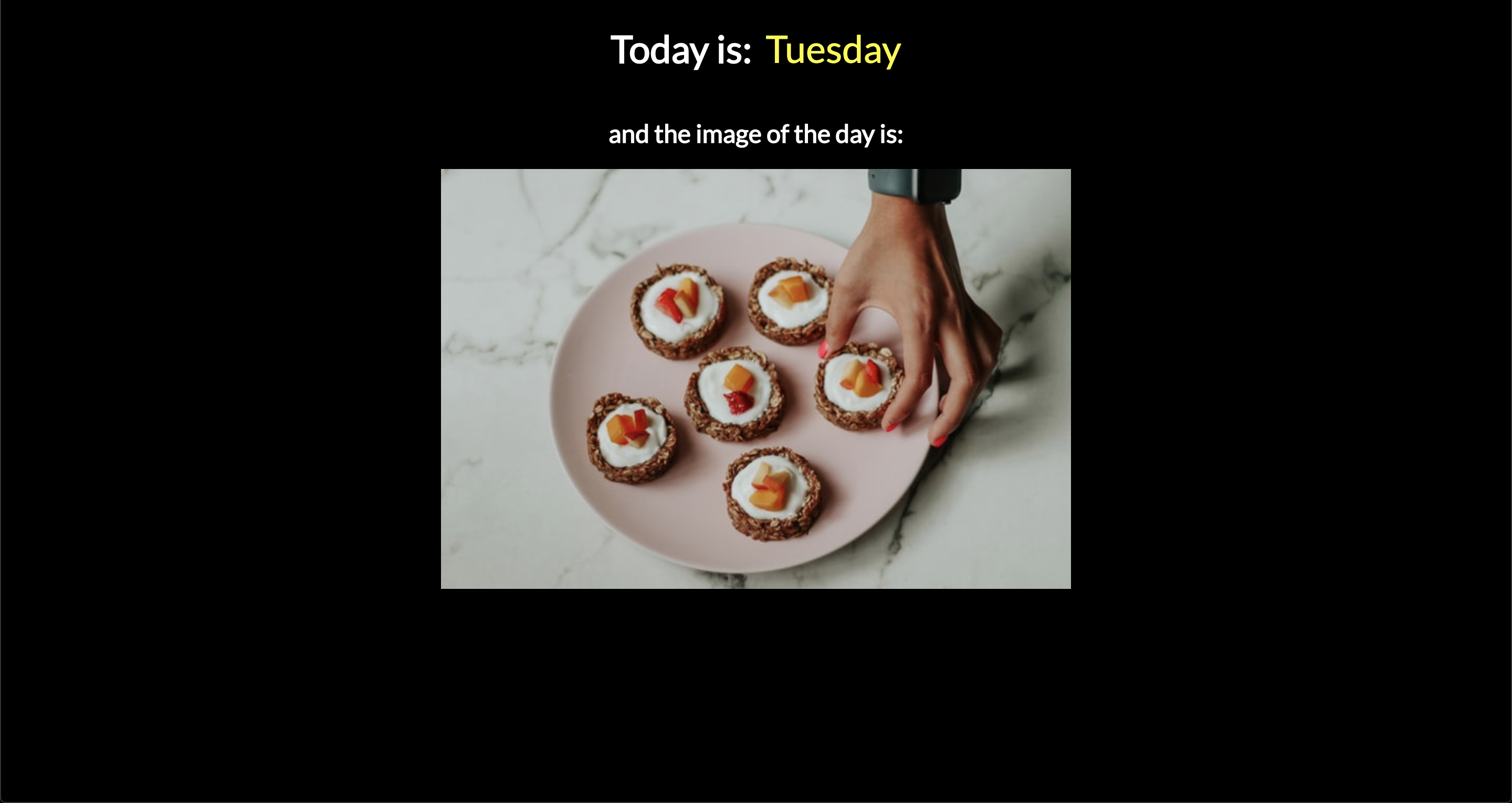 Webpage with black background, heading that includes the day of the week, and an image below.