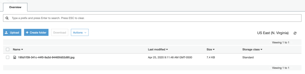 Screenshot of the AWS interface for buckets showing an uploaded file in a bucket that came from the Lambda function.